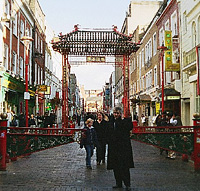 Pedestrians at the Chinatown gate
